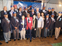 Chancellor France Cordova, University Librarian Ruth Jackson and Col. Ralph Smith with the original Tuskegee Airmen honored at Friday night's event.<br />