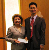 Beatrice J.S. LaPisto-Kirtley, AQMD board member and mayor of Bradbury, CA, presenting Wei Li with the $4,000 award check.