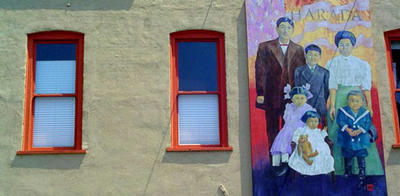 A mural by artist Marian Semic of the Harada family, displayed downtown on the outside of Semic's The People's Gallery, a non-profit art gallery at 3643 University Ave., the building that was once Jukichi Harada's restaurant.