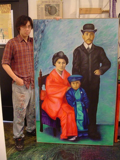 Riverside Community College student Mike Nguyen poses with his mural of the Harada family. His mentor is Marian Semic, who runs The People's Gallery.