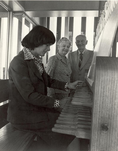 Phillip L. Boyd and his wife, Dorothy Marmon Boyd stand behind carillonneur Margo Halsted in this photo from the archives.