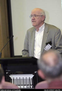 Henry Snyder speaks at a conference held at the National Library of Australia.