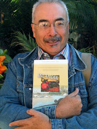 Juan Felipe Herrera, director of this year's Writers Week at UC Riverside, holding a copy of the new anthology