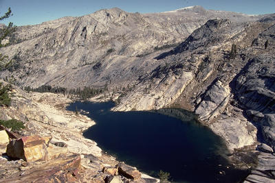 Because of extensive bedrock and little soil, Sierra Nevada lakes are very sensitive to changing climate and increased atmospheric fallout of nutrients.  Photo credit: J. Sickman, UCR.