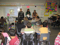 High school students (from left to right) Julian Sachs, Chi Nguyen, and Guadalupe Sanchez teach their own lesson plan to grade school students.