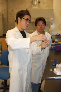 UCR student Adam Cheng (foreground) works in the lab of Assistant Professsor Jiayu Liao. (photo by Judy Chappell)