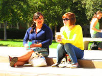 Students enjoy coffee near the bell tower