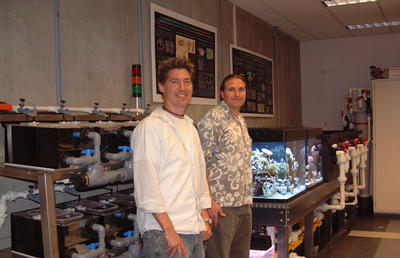 Professor David Kisailus (left) and research associate James Weaver (right), stand near the 500 gallon sea-water system in their lab. Photo by Douglas Duchon.