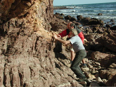 Geologists Chris von der Borch (front) and David Mrofka (back) look for evidence of ancient methane seepage within tidal sediments seen in sea cliff exposures at Marino Rocks, South Australia. Photo credit: M. Kennedy, UC Riverside.