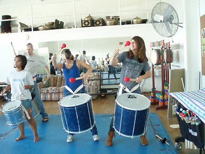 Gluck Fellows Ron Connor and MaryLouise Beck rehearse drumming techniques with Christina McCarty and Gary Price during a workshop at the Gluck Summer Camp for the Arts.