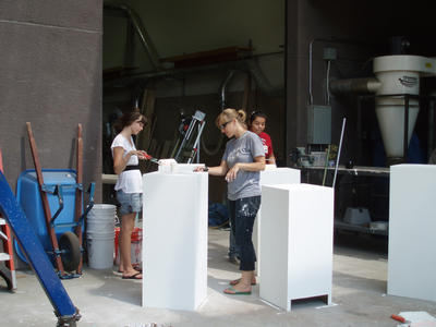 Gluck Fellow Alison Walker (center) and campers Julia Cummings and Anahi Contreras paint pedestals to be used in the Gluck Gallery during the final showing of the Summer Camp.