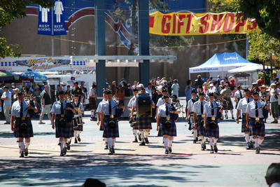 The UCR Pipe Band marches toward the competition venue at the Scottish Highland Games in Pleasanton.