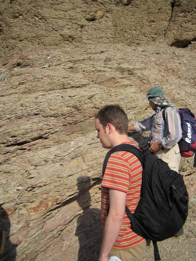UC Riverside's Gordon Love examining rock strata in northern Oman. Image credit: David Fike, Caltech.