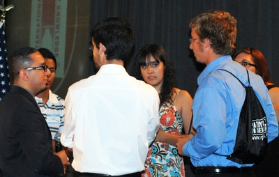 UCR Alumnus Ernie Rios, at left, meeting with scholarship recipients from the Coachella Valley.