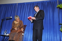 Maya Angelou accepts a gift: an issue of the Journal of African American History celebrating the life and scholarship of John Hope Franklin. (photo credit: Michael Elderman)