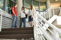 Students at the top of the stairs in the Highlander Union Building (HUB) on campus. Merit scholarships will help them pursue their highest dreams.