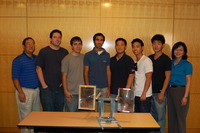 Members of one of UCR's two EPA P3 competition award-winning teams are (left to right) Professor Mark Matsumoto; students John Johnson, Chris Salinas, Parham Javadinajjar, Wesley Chen, Alex Chen, and Luke Chen; and engineering lecturer and team advisor Kawai Tam. The team is developing a system using a Fresnel lens to make drinking water from saline/brackish water. The next step in the project is to improve the device (foreground) by giving it the ability to track the sun.