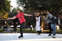 Students ice-skated near the bell tower during homecoming week. Even Scotty got into the act. Photo by Mandy Peone, UCR junior
