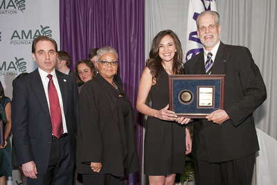 UCR medical student Marizabel Orellana receives the Medical Student Leadership Award from J. James Rohack, M.D., president of the American Medical Association. Also pictured, from left to right, are Richard Hovland, AMA Foundation president, and Freda Lewis-Hall, M.D., chief medical officer of Pfizer Inc.