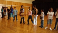 Elementary school students learn choreography in a previous Gluck Day of the Arts.