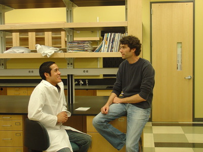 Sergio Alfaro (left) in conversation with Todd Fiacco, an assistant professor of cell biology and neuroscience at UC Riverside.  Photo credit: UCR Strategic Communications.