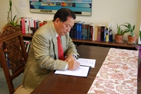 Jay Kim, a prominent Korean-American entrepreneur, signs a gift agreement that brings his total gifts and pledges to the Young-Oak Kim Center for Korean American Studies to $150,000.