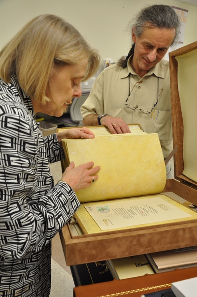 "Melissa Conway and Gwido Zlatkes examine ""Códice de Fernando I y Doña Sancha,"" a full-color facsimile of the manuscript dating from 1047.<br />"