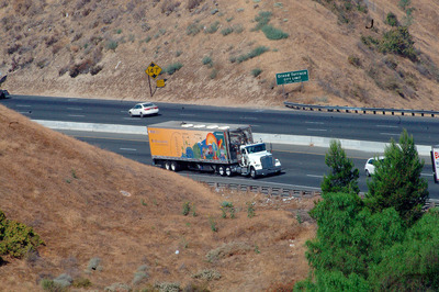 Mobile emissions truck on the freeway.