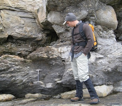 Lead author Noah Planavsky examines sedimentary rocks (diamictite) in Northern Norway that were deposited in the aftermath of one of the widespread 'Snowball Earth' glacial events.  Photo credit: Lyons lab, UC Riverside.