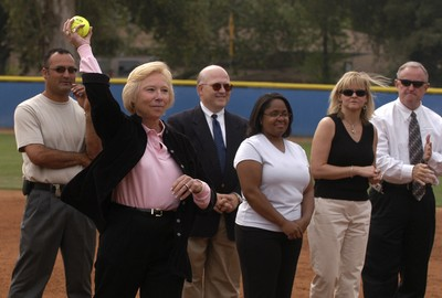 Hall of Fame inductee Amy Harrison throws a pitch at the dedication of a softball field named in her honor.