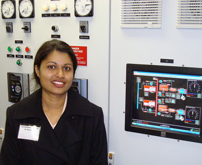 Varalakshmi Jayaram, a graduate student and the principle author of the report, stands in the control room of the hybrid tugboat.
