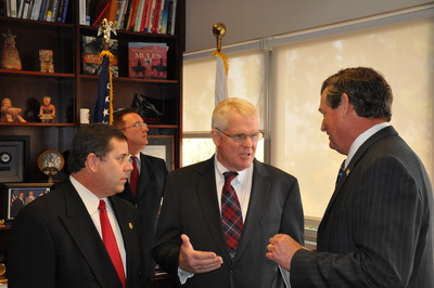 L to R: Riverside County Chief of Staff Dave Stahovich, Riverside County Supervisor Bob Buster, and UCR Chancellor Timothy P. White.  Background: Riverside County Foreign Trade Commissioner Tom Freeman.  Photo credit: UCR Strategic Communications.
