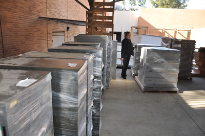 Linda Vida, the director of the Water Resources Center Archives, inspects materials as they arrive on the UC Riverside campus.  Photo credit: UCR Strategic Communications.