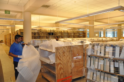 Movers unwrap the prized collection in UCR's Orbach Science Library.  Photo credit: UCR Strategic Communications.