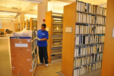 A mover begins shelving the prized collection in UCR's Orbach Science Library.  Photo credit: UCR Strategic Communications.