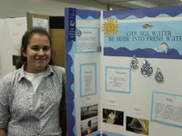 A student displays her science project at a recent Science and Engineering Fair at UC Riverside.  Photo credit: Strategic Communications.