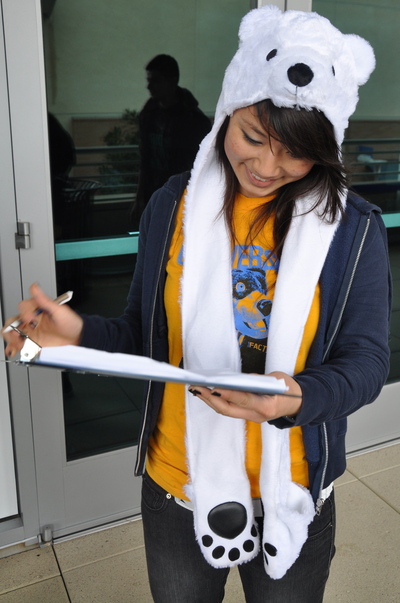 UCR student Diana Huang signs in before giving Scotty a hug along with 899 other official huggers.