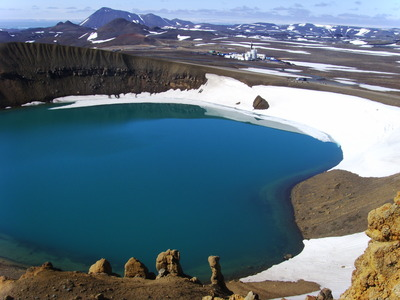 View of the Krafla volcano, Iceland, across the explosion crater Viti that erupted in 1787, showing the drilling rig. The borehole encountered molten rock at 6,500 feet depth. Photo courtesy of G.O. Fridleifsson.
