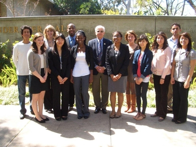From left: Fortino Morales III, Paige Stevens, Samantha Wilson, Cheng Ung, Nicholas Sakover, Serkadis Krohm, Executive Vice Chancellor and Provost Dallas Rabenstein, Christy Charles, Sara Crowder, Elizabeth Tizcareno, Cynthia De Leon, Ariel Reyes and Stacey Lumabao.