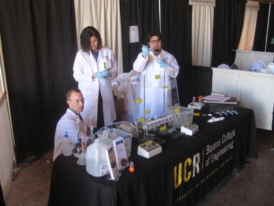 From left to right, Andrew Mikkelson, Cindy Brito and James Gutierrez at the team's table at the Waste-Management Education & Research Consortium contest in Las Cruces, N.M.
