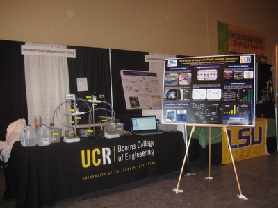 The team's table and poster at the Waste-Management Education & Research Consortium contest in Las Cruces, N.M.