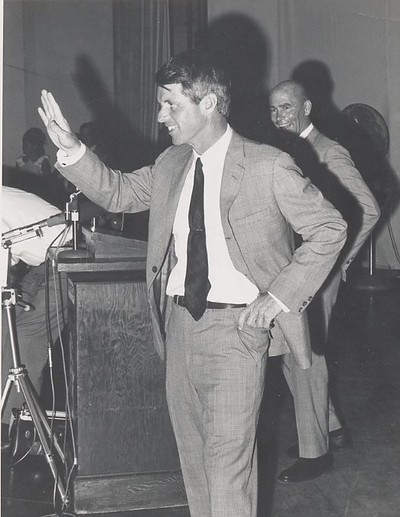 Douglas Coe (a student at UCR at the time) took this picture in Riverside at a rally for candidate Bobby Kennedy. Francis Carney can be seen in the background.