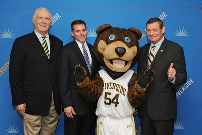 Posing with UCR mascot Scotty are (from left) retiring athletics director Stan Morrison, newly appointed athletics director Brian Wickstrom, and UCR Chancellor Timothy P. White.