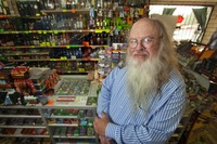 Robert Nash Parker, UCR professor of sociology, posing at a neighborhood liquor store. Photo by Peter Phun.