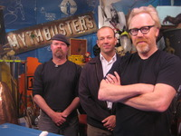 Kent Johnson, an assistant research engineer at the Center for Environmental Research and Technology, stands between Jamie Hyneman and Adam Savage, two of the hosts of