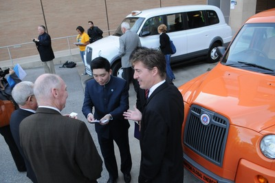 Electric cars powered with lithium ion batteries and made by Balqon are on display near Chung Hall. UCR Assistant Professor David Kisailus,  one of the professors working with funding designated by Chung for environmental research, is in the foreground. Photo by Carlos Puma.