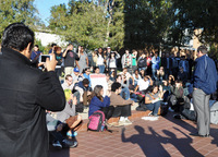 UCR's Chancellor White speaks at the bell tower with students, staff and faculty.