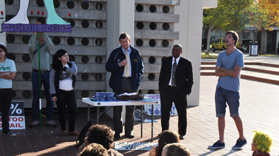 UCR Police Chief Mike Lane, who graduated from UCR, talks with people gathered at the bell tower about the challenges of protecting a large university campus.