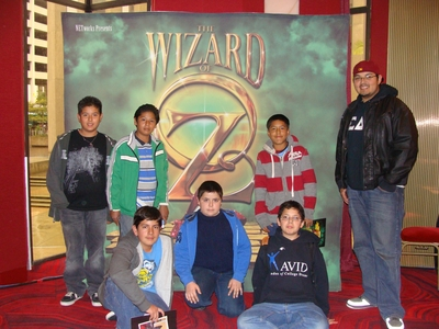 Students in the UC Riverside Educational Talent Search pose in front of a poster for the Wizard of Oz at the San Diego Civic Theater. Students visit a campus in the morning, then have a fun/cultural experience in the afternoon.
