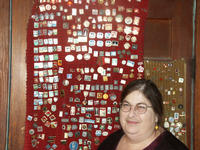 Marjorie Akin with a collection of Soviet and Czech pins.